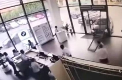 China woman takes BMW for test drive and crashes it into showroom